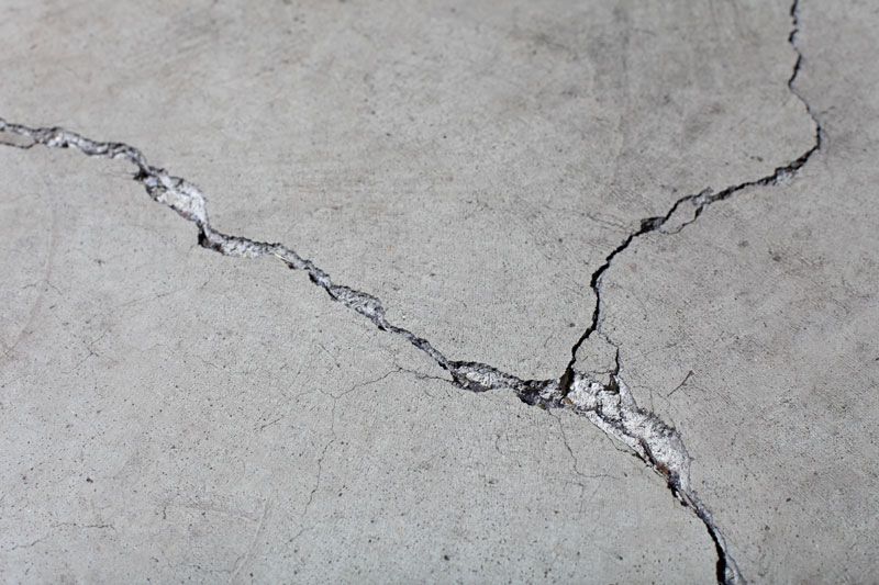 closeup of cracked concrete floor surface